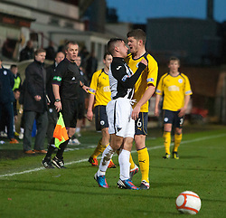 Dunfermline's Josh Falkingham squares up to Falkirk's Stewart Murdoch  after his tackle on Falkirk's Thomas Grant..Dunfermline 0 v 1 Falkirk, 26/12/2012..©Michael Schofield.