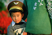 Boy in China wearing khaki army hat, Beijing, China
