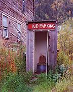 """No Parking"" outhouse behind the Chitina Emporium in Chitina, Alaska."