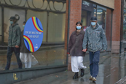 © Licensed to London News Pictures 28/10/2020. Nottingham  , UK. Α couple  wearing face masks walk  in the city centre before new restrictions come into force in Nottingham. The county of Nottinghamshire will enter into Tier 3 ,from 00:01 am on Friday 30 October. Photo credit: Ioannis Alexopoulos/LNP
