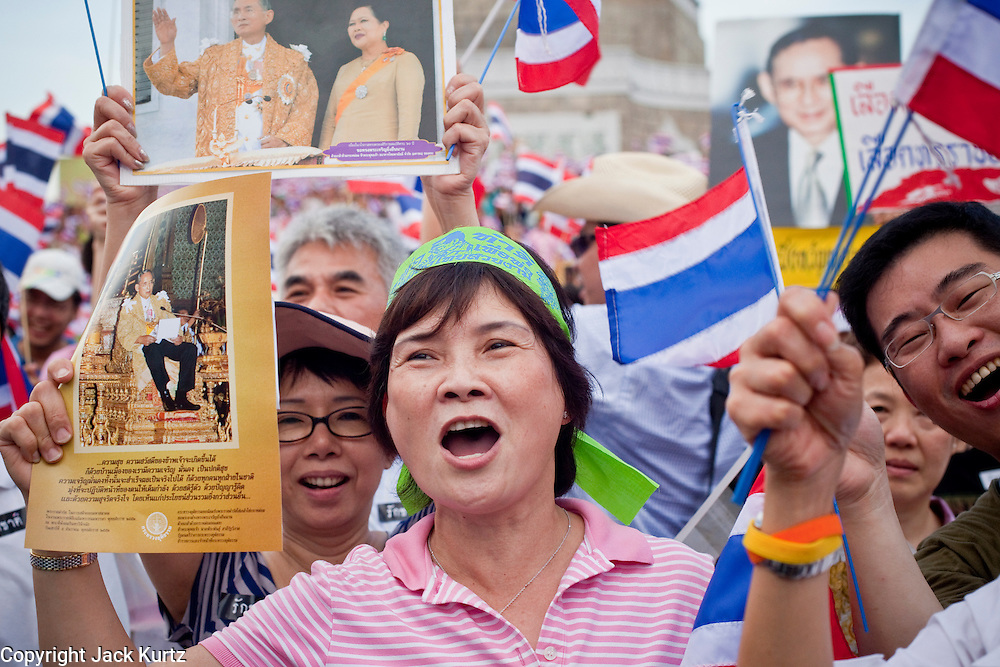 """Apr. 18, 2010 - Bangkok, Thailand: Pink Shirt peace demonstrators hold up photos of the Thai Monarch, King Bhumibol Adulyadej, during a rally against the Red Shirts Sunday. Thousands of so called """"Pink Shirts"""" jammed the area around Victory Monument in Bangkok to show support the Thai Monarch, King Bhumibol Adulyadej, and against the Red Shirts, who are demonstrating just a few kilometres away in the Ratchaprasong area. The Pink Shirts claim to not support either of the other political factions who wear colors - the Red Shirts, who support deposed Prime Minister Thaksin Shinawatra and their opponents the Yellow Shirts, who are against Thaksin.   Photo By Jack Kurtz"""