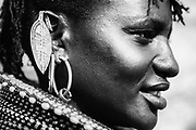 A portrait of a El Molo tribe women wearing beaded necklaces and metal earrings, ,black and white, Lake Turkana, Loiyangalani,Kenya, Africa