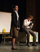 "Kaylee Lemire and Christian Ayer during dress rehearsal for ""The Universal Language"" one of six short comedies in ""All In The Timing"" at Gilford High School on Tuesday afternoon.  (Karen Bobotas/for the Laconia Daily Sun)"