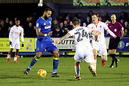 AFC Wimbledon midfielder Liam Trotter (14) passing the ball during the EFL Sky Bet League 1 match between AFC Wimbledon and Blackpool at the Cherry Red Records Stadium, Kingston, England on 20 January 2018. Photo by Matthew Redman.
