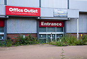 Office Outlet business closed down weeds growing in entrance, Ipswich, Suffolk, England, UK