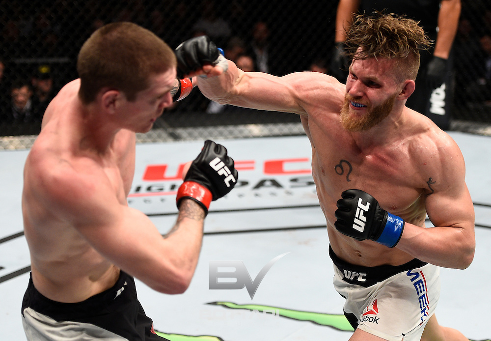 TORONTO, CANADA - DECEMBER 10:  (R-L) Emil Meek of Norway punches Jordan Mein of Canada in their welterweight bout during the UFC 206 event inside the Air Canada Centre on December 10, 2016 in Toronto, Ontario, Canada. (Photo by Jeff Bottari/Zuffa LLC/Zuffa LLC via Getty Images)