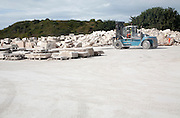 Fork lift truck operating at Portland Stone Firms Limited, the world's largest supplier of Portland stone, Isle of Portland, Dorset, England
