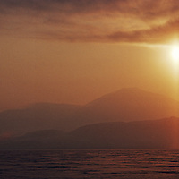 The midnight sun glistens over Lake Hazen and the United States Range in Quttinirpaaq National Park, Ellesmere Island, Nunavut, Canada.