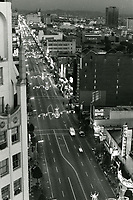 1975 Looking east at Hollywood Blvd. & Highland Ave. at night during Christmastime