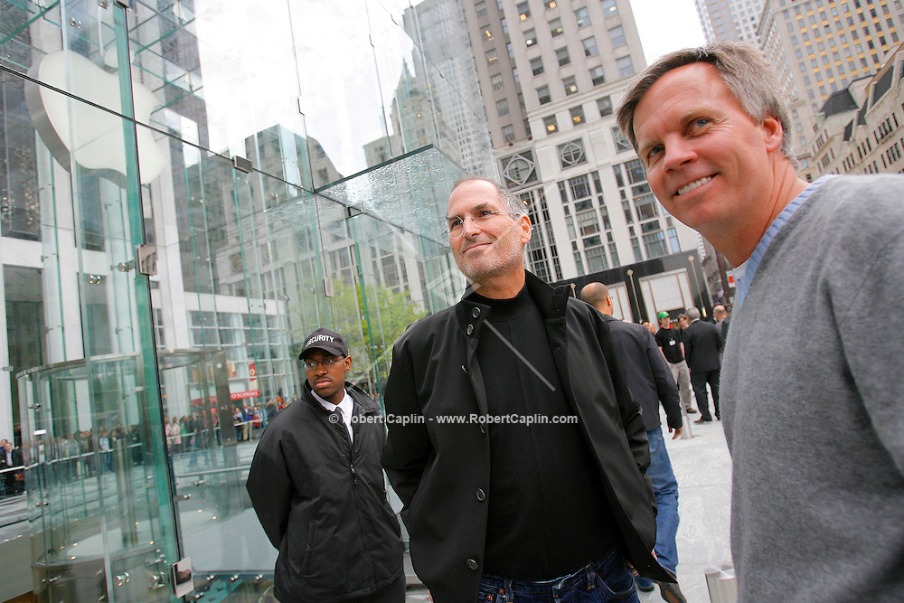 Steve Jobs, Apple Computer, Inc. chief executive officer, left, and Ronald Johnson, senior vice president of retail for Apple Computer, Inc., stand outside the new Apple Store in New York moments prior to the grand opening on Friday, May 19, 2006. Apple Computer Inc., maker of the iPod music player, opened a 24-hour subterranean store in New York City, marking five years in retailing with an outlet built beneath a 32-foot glass cube.