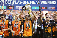 Chuba Akpom of Hull City lifts the Sky Bet Championship Playoff Trophy with his teammates .Skybet football league Championship play off final match, Hull city v Sheffield Wednesday at Wembley Stadium in London on Saturday 28th May 2016.<br /> pic by John Patrick Fletcher, Andrew Orchard sports photography.