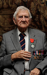 Veteran Basil Playle, 100, shows his Legion d'honneur medal, France's highest distinction, presented to him from the French Ambassador Sylvie Bermann for his role in liberating France during the Second World War, during a ceremony at the Ambassador's residence in Kensington, London.