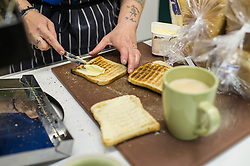 Volunteers preparing breakfast at a soup kitchen.