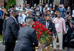 George Floyd's casket is taken from a private memorial service in the Frank J. Lindquist Sanctuary at North Central University in Minneapolis on Thursday, June 4, 2020. (Elizabeth Flores/Minneapolis Star Tribune/TNS)