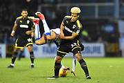 Lyle Taylor (33) of AFC Wimbledon fouls Daniel Leadbitter (2) of Bristol Rovers during the EFL Sky Bet League 1 match between Bristol Rovers and AFC Wimbledon at the Memorial Stadium, Bristol, England on 18 November 2017. Photo by Graham Hunt.