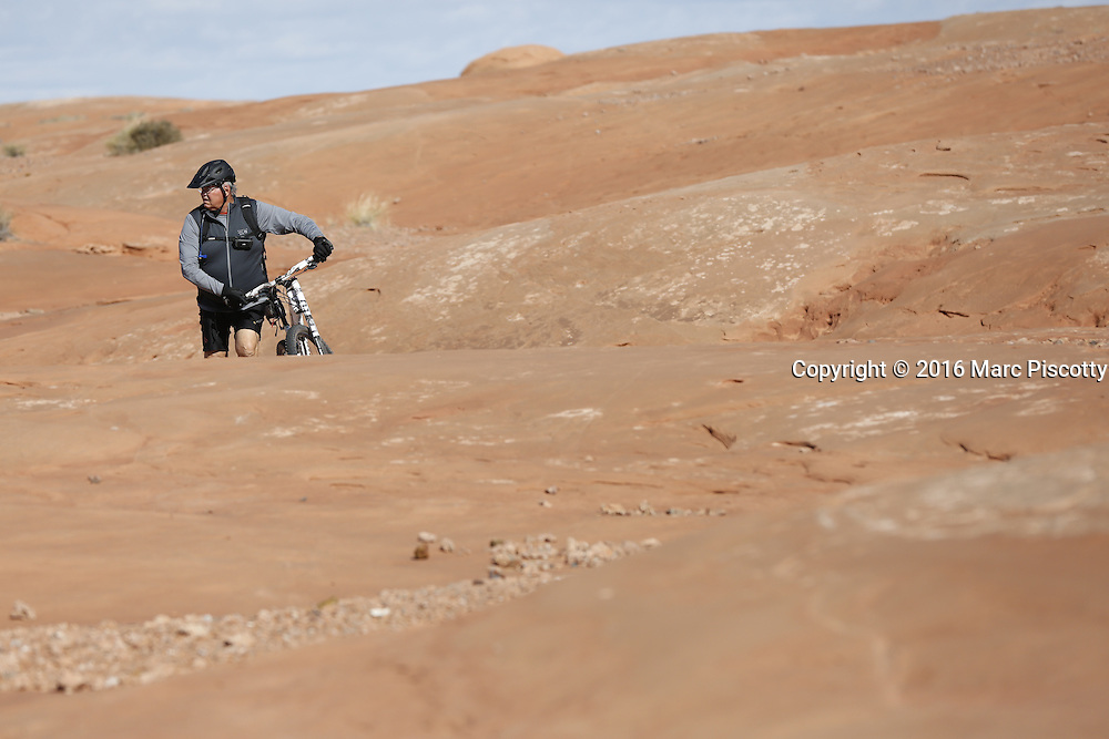 SHOT 10/18/16 11:09:14 AM - Emery County Utah tourism photos including hiking and exploring Goblin Valley including an arch rappel, the Black Dragon Canyon and  mountain biking Saucer Basin with Lamar Guymon. (Photo by Marc Piscotty / © 2016)
