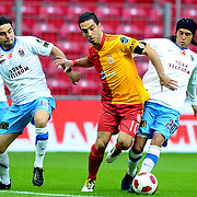 Galatasaray's Arda TURAN (C) and Trabzonspor's Gustavo COLMAN (R), Selcuk INAN (L) during their Turkish superleague soccer derby match Galatasaray between Trabzonspor at the TT Arena in Istanbul Turkey on Sunday, 10 April 2011. Photo by TURKPIX