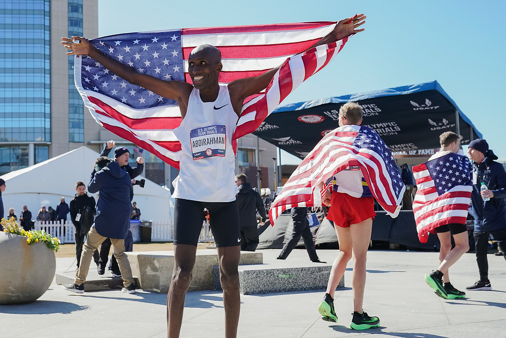 Abdi Abdirahman celebrates placing third during the 2020 U.S. Olympic marathon trials in Atlanta on Saturday, Feb. 20, 2020. Photo by Kevin D. Liles for The New York Times