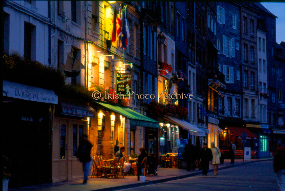 France, Normandy.  Honfleur, Restaurants in Old harbour, at night