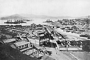 Russo-Japanese War 1904-1905:  View of Port Arthur a few days before its fall, showing stranded Russian battleships, July 1904.