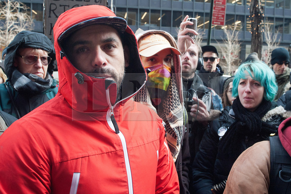 "© licensed to London News Pictures. New York City, New York, USA. 3/01/12. Activist Andy Stepanian speaks at anti-NDAA protest about his experience experiences being imprisoned under terrorism charges after the 'SHAC 7 trial' and of the case of Abu-Sayyaf who was imprisoned with him in a secretive detention centre called a 'Federal Communication Management Unit' on charges of providing monetary aid to a ""terrorist organization"". Protests take place in manhattan against the recently passed National Defence Authorisation Act (NDAA), which protesters are concerned introduced indefinite detention powers to be used against those suspected of terrorism. Photo credit: Jules Mattsson/LNP"