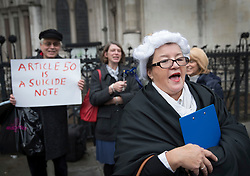 © Licensed to London News Pictures. 13/10/2016. London, UK. Anti-EU referendum result protestors (L) look on as a woman dressed as a lawyer calls for democracy outside the High Court. A legal challenge is being launched, after the EU referendum result, to force the government to seek Parliamentary approval before Brexit negotiations begin. Photo credit: Peter Macdiarmid/LNP