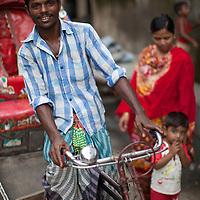 A rickshaw driver in the Outfall Slum, Dhaka, Bangladesh