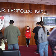 A stadium tour group listen to a presentation by a River Plate tour guide during a visit to River Plates' El Monumental stadium, Buenos Aires, Argentina, 25th June 2010. Photo Tim Clayton..
