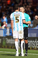 Mark Hudson of Huddersfield Town is given a talking to by Referee Iain Williamson. Skybet football league Championship match, Huddersfield Town v Sheffield Wednesday at the John Smith's Stadium in Huddersfield, Yorkshire on Saturday 2nd April 2016.<br /> pic by Chris Stading, Andrew Orchard sports photography.