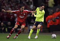 Photo: Paul Thomas.<br /> Liverpool v Barcelona. UEFA Champions League. Last 16, 2nd Leg. 06/03/2007.<br /> <br /> Alvaro Arbeloa (L) tries to tackle Lionel Messi of Barcelona.
