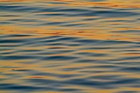 Sunset reflected in the waves of the sea