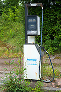 Abandoned  fuel filling station with generic derelict petrol pump in Wales, UK