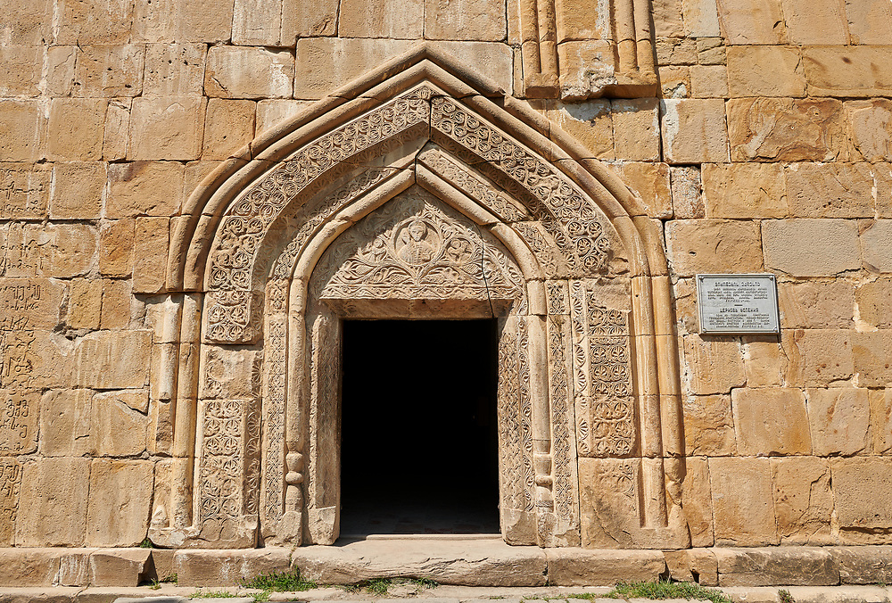Pictures & images of the Church of the Assumption exterior bas relief Georgian stone work around the doorway,1689, Ananuri castle complex & Georgian Orthodox churches, 17th century, Georgia (country).<br /> <br /> Ananuri castle is situated next to the Military Road overlooking the Aragvi River in Georgia, about 45 miles (72 kilometres) from Tbilisi. It was the castle of the eristavis (Dukes) of Aragvi from the 13th century and was the scene of numerous battles. In 2007 Ananuri castle was enscribed on the   UNESCO World Heritage Site tentative list. .<br /> <br /> Visit our MEDIEVAL PHOTO COLLECTIONS for more   photos  to download or buy as prints https://funkystock.photoshelter.com/gallery-collection/Medieval-Middle-Ages-Historic-Places-Arcaeological-Sites-Pictures-Images-of/C0000B5ZA54_WD0s<br /> <br /> Visit our REPUBLIC of GEORGIA HISTORIC PLACES PHOTO COLLECTIONS for more photos to browse, download or buy as wall art prints https://funkystock.photoshelter.com/gallery-collection/Pictures-Images-of-Georgia-Country-Historic-Landmark-Places-Museum-Antiquities/C0000c1oD9eVkh9c