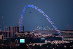 © Licensed to London News Pictures. 07/05/2020. London, UK. Wembley Stadium is floodlit blue for Clap for Carers.. Photo credit: Peter Macdiarmid/LNP