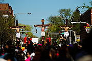 Members of St. Agnes of Bohemia Catholic Parish re-enact a traditional Good Friday Via Crucis, or Way of the Cross procession weaving through the Mexican enclave of Little Village on Chicago's southwest side. Portraying Jesus Christ is Mario Ocampo. April 6, 2012 l Brian J. Morowczynski~ViaPhotos..For use in a single edition of Catholic New World Publications, Archdiocese of Chicago. Further use and/or distribution may be negotiated separately. ..Contact ViaPhotos at 708-602-0449 or email brian@viaphotos.com.