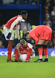 10 January 2018 -  EFL Cup - Semi Final (1st Leg) - Chelsea v Arsenal - Concern from Alex Iwobi and David Ospina of Arsenal for Jack Wilshere after he picks up an injury - Photo: Marc Atkins/Offside