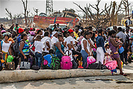 Evacuees gather at Marsh Harbour Dock awaiting to leave the Great Abaco Island on Friday, September 6, 2019, after Hurricane Dorian swept through the Bahamas.