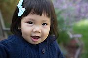 Asian toddler girl in blue jumper