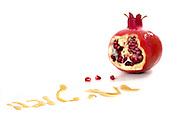 pomegranate, seeds, and honey Symbols of Roah Hashanah the Jewish New Year on white background