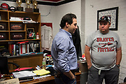 Iraan High School football head coach Mark Kirchhoff visits with Texas House member Poncho Nevarez who stopped by to wish the team good luck in their state title game in Iraan, Texas on December 13, 2016. (Cooper Neill for The New York Times)