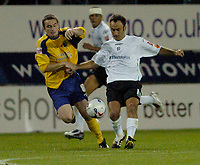 Photo: Leigh Quinnell.<br /> Luton Town v Southampton. Coca Cola Championship.<br /> 09/08/2005. Lutons Ahmet Brkovic battles with Southamptons Matt Oakley