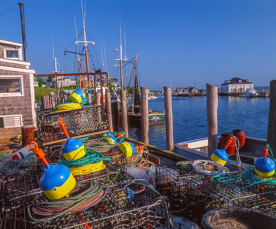 Colorful fishing gear & lobster traps on dock, boats docked, Coast Guard Station in distance, Marthas Vineyard, Menemsha, MA