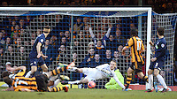 Southend United's Daniel Bentley saves from Hull City,s David Meyler<br /> Photo by Kieran Galvin/CameraSport<br /> <br /> Football - FA Challenge Cup Fourth Round - Southend United v Hull City - Saturday 25th January 2014 - Roots Hall - Southend<br /> <br />  © CameraSport - 43 Linden Ave. Countesthorpe. Leicester. England. LE8 5PG - Tel: +44 (0) 116 277 4147 - admin@camerasport.com - www.camerasport.com