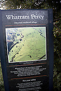 Information board medieval deserted village, Wharram Percy, Yorkshire, England