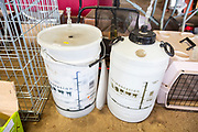 Plastic wine-making home brewing  fermentation bins on display in house clearance auction sale room, UK