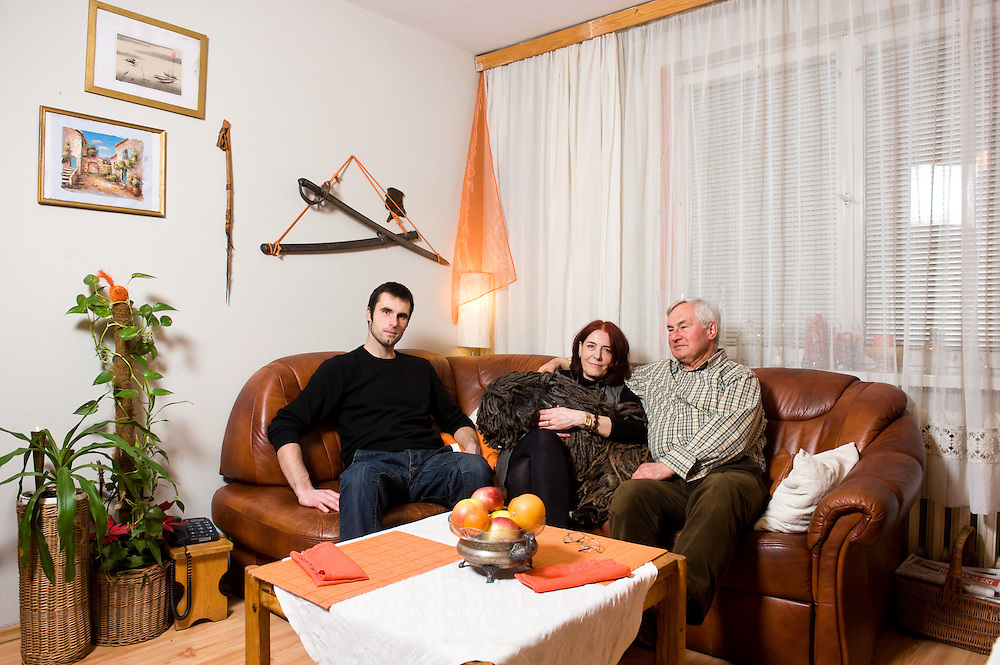 Iwona 58, Antoni 71, Mateusz 26 <br /> <br /> Nowa Huta, Kraków, Poland  average income, higher education <br /> <br /> Iwona works in the Steelwork's Foundation of Health Protection and Social Welfare. <br /> Antoni is a pensioner; he used to work as an industrial psychologist in Sendzimir steelworks.<br /> Mateusz is a sociologist with a specification on multimedia and human communication and now he is doing his MA in the cultural changes of Nowa Huta <br /> <br /> Everyone is coming home at different times so we don't always eat together. It depends on the day. If we can meet all together then we eat together. Every Sunday Iwona  either with Antoni or with Mateusz visits her mother Alina 80 in an nursing home. Sometimes they stay there longer and in that case Sunday lunch is later. The family dinner could be a celebration when we have time, but when we are in a hurry it is just a way to comfort our hunger. A good meal depends on the heart of the cook, on products and on how much time we have. During our dinners we are talking because we are all together. Sometimes we invite friends and we stay around the table for hours. We would be glad to have all of our family around the table and talk for hours but for that we have to wait until the summer holidays when Marta the daughter of Antoni comes to Poland from California with her family.
