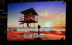 """A message reading """"With love from the Gold Coast"""" is displayed on the big screen during the Closing Ceremony for the 2018 Commonwealth Games at the Carrara Stadium in the Gold Coast, Australia."""