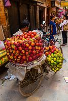 Merchant selling apples on the street, Kathmandu, Nepal.