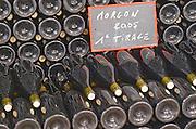 Bottles aging in the cellar. Domaine Gravallon Lathuiliere, Morgon, Beaujolais, France