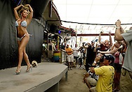 Kristin, a contestant in the Miss Seacrets Contest from Harford County, Maryland, walks off stage during the second round of the summer long bikini contest held Sunday at Seacrets in Ocean City.